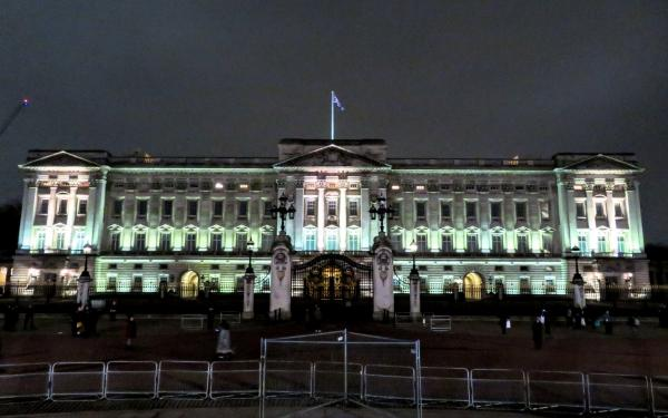 Buckingham Palace is the Queen's weekday home, which she refers to as her office. Her back yard consists of heavily guarded gardens with barbed wire and electric fences reminiscent of Jurassic park. Her front yard is basically London.